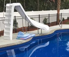 Swimming Pool Extras That Won't Break The Bank Swimming Pool Slides, Swimming Pool Images, Pool Safety Net, Pool Nets, Inground Pool Designs, Fiberglass Swimming Pools, Robotic Pool Cleaner, Pool Accessories, Pool Fence