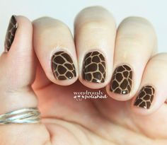 Hello, animal print! Lindsey from Wondrously Polished used thin nail art brushes to achieve this look. While she started with a light brown base coat and drew on multi-shaped dots in a darker brown, it might be easier to start with a dark brown base and draw on lighter lines to create the illusion of a giraffe print.