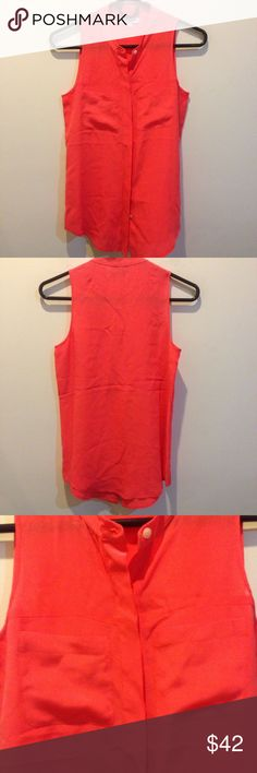 Madewell Neon Silk Sleeveless Button Down Shirt This gorgeous Madewell blouse is a neon orange and is sleeveless. Features a button down center front with concealed buttons , two top front pockets and is made of silk! Worn lightly and no apparent signs of wear. Size extra small. Madewell Tops Button Down Shirts