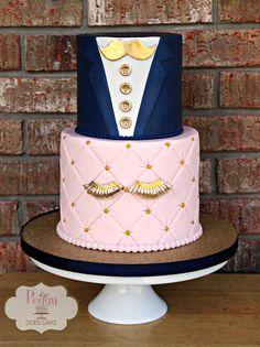 staches or lashes gender reveal cake in navy, pink, and gold. #genderrevealcake #stachesorlashescake #quiltedcake #tuxedocake #mustachecake #lashescake #babyrevealcake #revealcake #navycake #pinkcake #centralmscakes #jacksonmscakes #peggydoescake