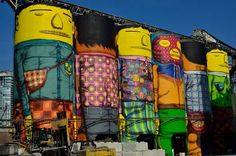 Brazilian graffiti artists Os Gemeos were invited to the Vancouver Biennale to turn six multi-story silos on Granville Island into their trademark 'Giants.' The murals on the 70-foot towers are now the largest paintings ever attempted by the pair, an astounding feat considering Os Gemeos completely donated a month of their time to create the non-profit art project.
