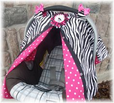 Carseat Canopy Cover..  Must have to protect your little ones from wind, rain, and germs.