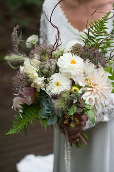 This bridal bouquet features garden flowers including blush dahlias, raspberries, ferns and ammi.  Designed by The Blue Carrot.