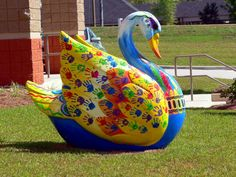 I have so many pictures of these. hehe @Aerish , remember hunting for them?! :) Street Art Swans Placed at Business Buildings, Hattiesburg, Mississippi
