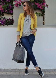 bright blazer, fun/graphic sweater, blue jeans, sneakers