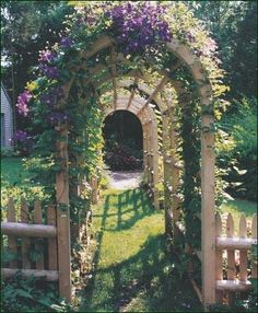 Rustic Gallery Arbor - That simplicity can also be charming is evident in this Rustic Arbor that continues like a Pergola to form a delightful walkway.