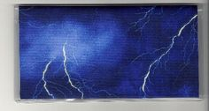"Storm Clouds Lightning Strike Checkbook Cover by Tickled Pink Boutique. $5.99. The sturdy clear VINYL COVER encases a fabric bonded design. Measuring 6 1/4"" x 3 1/4"",  the cover fits all standard bank checkbooks and banking registers.  All checkbook covers come with a register flap and a duplicate check flap  just like the bank, only flashier.  These checkbook covers are a great alternative to the expensive covers offered by banks and online check companies."