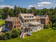 Magnificent brick and stone Georgian Manor crafted with timeless elegance and grandeur, a gracious loggia opens onto a grand elevated stone terrace that overlooks the Hudson River! Catherine Zeta Jones, Irvington New York, Manhattan, Cosy Lounge, Georgian Mansion, Modern Bungalow House, Indoor Swimming Pools, Summer Kitchen, Brick And Stone