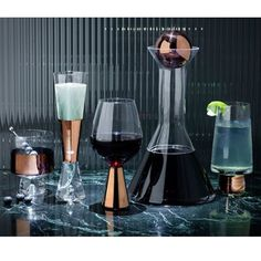 Tom Dixon's Tank Jug is made from mouth blown clear glass. Designed with hand painted copper detailing, heavy and generously proportioned glass with Tom Dixon's logo sandblasted on the base. http://www.yliving.com/tom-dixon-tank-jug.html