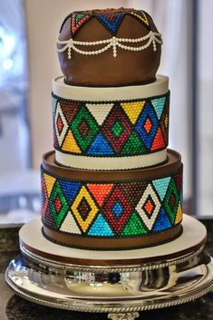 The colourful & vibrant wedding cake of Zimbini & Mbulelo at Chez Charlene, 5 Star Wedding Venue, Pretoria East, Gauteng, www. Best Picture For small traditional wedding cakes For Your Beaded Wedding Cake, Zulu Wedding, Star Wedding, Wedding Hijab, Wedding Dresses, African Wedding Cakes, African Wedding Theme, Zulu Traditional Wedding, Traditional Cakes