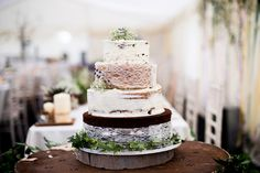 Image by Nicola Norton Photography - Justin Alexander lace wedding gown & Jim Hjlem Occasions bridesmaid dresses in a rustic barn wedding with horses & stables and groom in traditional morning suit
