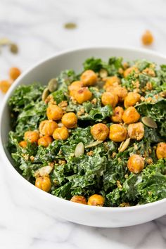 This vegan kale caesar salad recipe is a simple + light dinner that everyone will love. Served with a creamy tahini dressing + topped with crispy chickpeas!