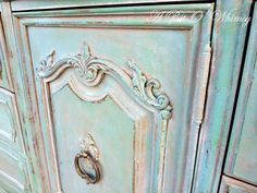 gorgeous verdigris finish on a dresser using Provence, Antibes Green, and Old White annie sloan chalk paint via A Bit of Whimsy