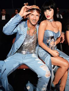 "Gotcha! VMAs Moments You Didn't See on TV | GOOD JEANS | Why do those outfits look so familiar? Riff Raff and Katy Perry (who proudly holds her Moon Man for best female video for ""Dark Horse"") channel Britney Spears and Justin Timberlake's famous all-denim getup, circa 2001. ""About to roll thro,"" posted Perry on Instagram, giving a sneak peak of the look before their arrival."