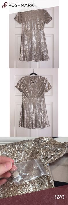 Beauiful new sparkly sequin dress ✨ This dress is perfect for New Year's Eve and other holiday parties! It's in excellent condition, never been worn. It lost the original tag but the extra button is still attached. It's definitely a mini dress that shows off your legs. It really is a beautiful dress, mostly gold in color with silver undersides of the sequins. ❤️Spend over $20 (excluding shipping) and get a free gift!❤️ Forever 21 Dresses Mini