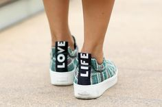 street style detail shot: sweet sneakers spotted at new york fashion week