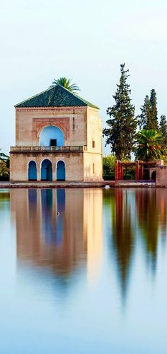Pavillion reflection on Menara Gardens basin at Marrakech, Morocco