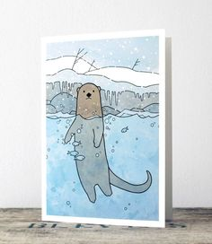 An illustrated card for the holidays featuring a River Otter in a stream. Set in a whimsical Winter scene with a snow covered bank, icicles, and falling snow! A blank inside, suitable for Christmas or