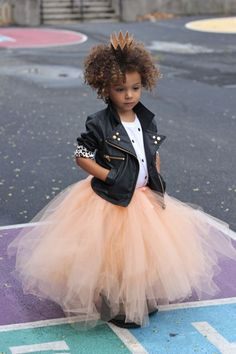 A pink tulle skirt adds a girly touch to this structured moto jacket.