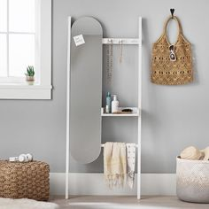 With hooks for coats and bags, a shelf for keys and a phone, and a mirror for last-looks before heading out the door, this get-ready station keeps everything in its proper place. Or use it for organizing jewelry, hair accessories and makeup. Add our Leaning Storage Shelves for even more storage options.  Pottery Barn Teen Leaning Get Ready Station