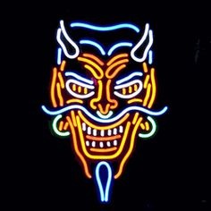 "DEVIL NEON SIGN-NN5DEVLP  15"" wide, 24""high, 4"" deep  Perfect for your biker bar or tattoo shop, our Devil Neon Sign, featuring multi-colored, hand blown tubing supported on a black, finished metal grid. The Devil Neon Sign can be displayed flat on a wall or in a window or alternately be placed upon a shelf."