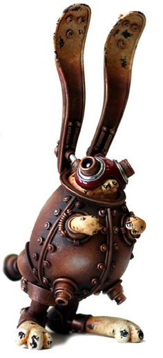 """'What does it do?' I asked, studying the curious creature occupying his desk. 'Do?' he laughed. 'It sits there, Miss St. Croix. Don't be ridiculous.'"" (Steampunk Sculptures by Michihiro)"