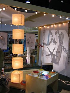 Having fun with shadows and lamps while decoration a daycare or preschool classrom -- idea following principals of Inspiring Spaces for Young Children book (similar to Reggio Emilia Approach). [Image from Kaplan Early Learning Company booth at NAEYC 2010]