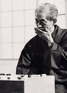 Yasunari KAWABATA, a Nobel Prize-winning novelist (1899~1972), playing Go (Japanese board game) at his home in Japan.