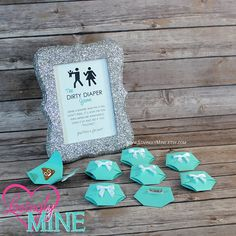 Dirty Diaper Game with Light Teal Diaper Pins and matching Silver Glitter Frame This listing is for a package size and type (DIY or Fully Assembled) of your choice, just view all options available in the drop down menu when adding to your cart. Each package will include handmade 65lbs