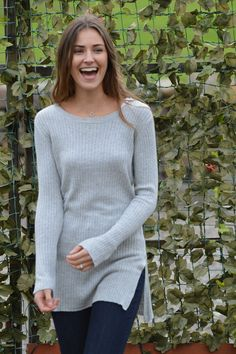 Happy Kinda Life - Superfine ribbed cotton blend, teams perfectly with sophisticated tunic length in this luxe top.  Sleek and stunning, this tunic jumper is perfect for adding a little casual elegance to your wardrobe.
