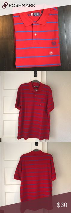 Chaps red and blue stripes men's polo shirt NWT. Chaps red and blue stripes men's polo shirt. Size L. 100% cotton. Chaps Shirts Polos