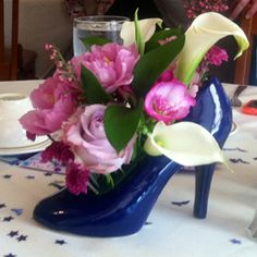 High Heel vase for party centerpiece. Wonderful for bridal showers and wedding receptions too. www.sassydezines.com  520-744-2417