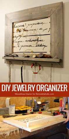 Put your necklaces and bracelets in order with this easy custom DIY jewelry organizer. It features a small ledge shelf plus hooks for necklaces, and the backing is  fabric covered pinboard so you can leave yourself reminders and customize your hanging jewelry for rings, brooches, and more. Make it in any size you need to fit your space and your accessories. #organizer
