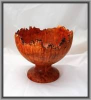 ARBUTUS BURL NATURAL EDGE PEDESTAL BOWL -A rare and beautiful Arbutus burl bolw with a Natural Edge. The bowl shows 'birds eye' markings. Turned from locally grown wood on Vancouver Island. Food safe.     Height 7 inches by Diameter 8.5 inches.