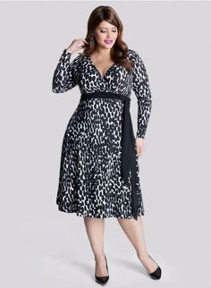This black and white true wrap dress has asymmetrical abtruse black dots, long sleeves, a surplice bodice and figure flattering A line skirt . #PlusSize
