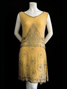 "Beaded silk crepe/satin evening dress, c.1920. Label: ""Frances & Co. Dressmakers, Inc./10 West 56th St./New York."""