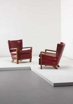 """JEAN ROYÈRE  Pair of """"Ecusson"""" armchairs,1953  Oak, leather (2).   Each: 29 1/2 in. (75 cm.) high"""