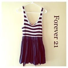 Forever 21 dark blue and white dress Has a zipper on the side of it. The top part is 95% rayon and 5% elastic, bottom part is 100% cotton. The waistband has a tie to put around back to loosen or tighten if needed. Pre loved. True to size. No trades ✅ Price Negotiable  ✅ Bundles ▪️smoke free/pet free home  Same/Next day shipping   Instagram: @laurenweichmann Pinterest: weichln Forever 21 Dresses