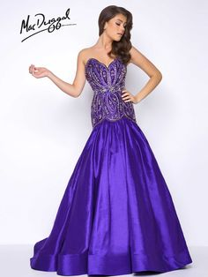 Sweetheart neckline, dropped waist, open back, satin prom dress with embellishments hitting just below the hips and full skirt.