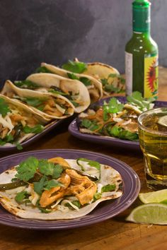 Create a killer taco bar with these pulled chicken tacos with homemade buffalo sauce, red onions, and Poblanos.