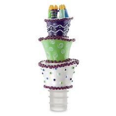 """Hand Painted Resin Birthday Surprise Bottle Stopper by HomeAndWine.com. $9.95. Dimensions: 2"""" x 5 1/4"""". Hand painted bottle stopper. Ridged rubber seal feathery marabou. Hand painted bottle stopper with ridged rubber seal feathery marabou. Gift box with window. Master quantity 2"""