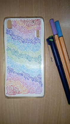 Mobile cover using a paper cut out of the phone design and colourful pens..  The cutout can be placed inside the transparent cover...