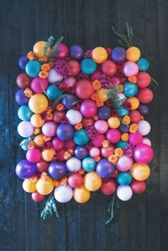 Balloons and Flowers DIY Wedding Backdrop | This DIY backdrop would make a fun and colorful backdrop for your photo booth.