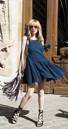 The 70′s Fashion Trends: Louise Ebel is wearing a navy Free People dress with a brown fringed Spell And The Gypsy sidebag
