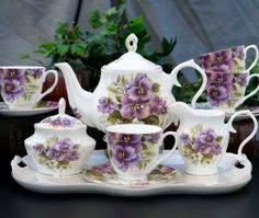 Create a flattering tea table with this lavish Pansy Bone China tea set. The ornamental pansies pop with color against the white bone china background. It includes 1 Teapot, Sugar Tea Cup Saucer, Tea Cups, Rosa Rose, China Tea Sets, Tea Pot Set, Teapots And Cups, My Cup Of Tea, Tea Service, Coffee Set