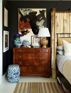 Contemporary art and antiques in bedroom decor