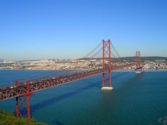 The 25 de Abril Bridge is a suspension bridge connecting the city of Lisbon, capital of Portugal, to the municipality of Almada on the left (south) bank of the Tejo river. Visit Portugal, Spain And Portugal, Portugal Holidays, San Francisco, Lower Deck, Suspension Bridge, Natural Scenery, Travel Articles, Train Tracks