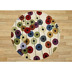 @Overstock - This hand-made Metro rug features a bright geometric pattern of circles and lines. A blended New Zealand wool construction gives this stylish round rug an elegant make up.http://www.overstock.com/Home-Garden/Hand-made-Metro-New-Zealand-Wool-Rug-6-Round/6740626/product.html?CID=214117 $197.99