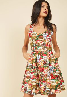 Deck the Meows A-Line Dress | Mod Retro Vintage Dresses | ModCloth.com  Don this patterned dress as your yuletide apparel and you'll be brimming with good cheer! Printed with festive cats outfitted in Santa hats and trimmed with boughs and baubles, this red, green, gold, and white dress with pockets ensures everyone you see will follow you in merry measure.