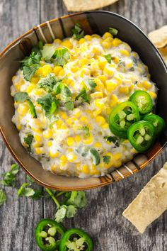 Crisp, sweet and creamy with just a little kick. Slow Cooker Sweet Corn and Jalapeno Dip is the perfect appetizer while you're watching the game!